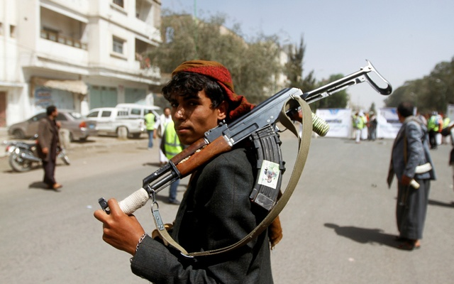 A Houthi supporter looks on as he carries a weapon during a gathering in Sanaa, Yemen April 2, 2020. REUTERS