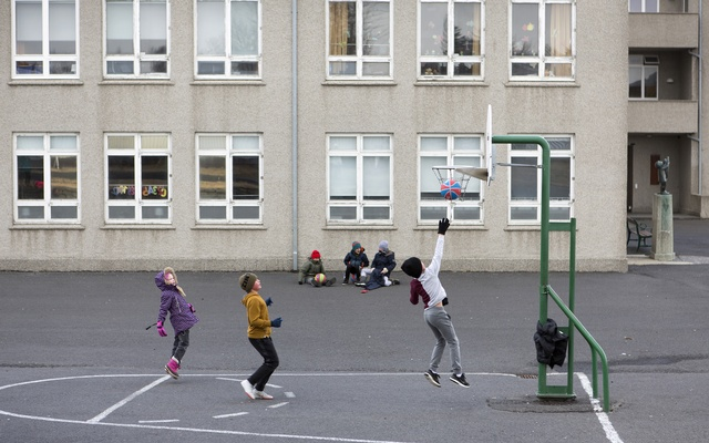 Students play during recess at a school in Reykjavik, Iceland, April 1, 2020. The New York Times