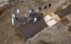 Drone pictures show bodies being buried on New York's Hart Island where the department of corrections is dealing with more burials overall, amid the coronavirus disease (COVID-19) outbreak in New York City, US, April 9, 2020. Reuters