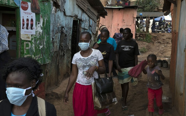 People wear protective face masks in the Kibera slum in Nairobi, Kenya on Tuesday, April 7, 2020. The New York Times