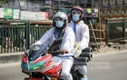 Two staff members of a private company on a motorcycle transporting oxygen cylinders ordered online in Dhaka as online shopping has surged amid a shutdown due to the coronavirus outbreak. Photo: Mahmud Zaman Ovi