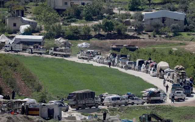 Vehicles carrying belongings of internally displaced Syrians drive back to their homes, as some people are afraid of the coronavirus disease (COVID-19) outbreak in crowded camps, in Dayr Ballut, Syria Apr 11, 2020. REUTERS