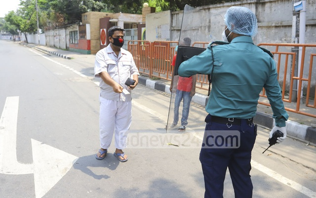 The police continued their daily routine of questioning people about their reasons of getting out of home amid the lockdown. Photo: Asif Mahmud Ove
