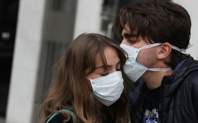 Marco Donoso del Bufalo, 20, a young man on the autism spectrum, kisses his sister Irene, 22, as they take their daily walk during the lockdown amid the coronavirus disease (COVID-19) outbreak in Madrid, Spain, Apr 9, 2020. REUTERS