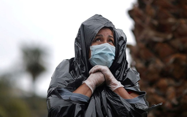 Juana Gomez, 50, who said she can't afford rent and food for her six children after her husband lost his construction job, stands in the rain in a line to pick up fresh food at a Los Angeles Regional Food Bank giveaway of 2,000 boxes of groceries, as the spread of the coronavirus disease (COVID-19) continues, in Los Angeles, California, US, April 9, 2020. Reuters