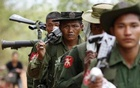 Army soldiers carry weapons in Tarlay, Myanmar March 28, 2011. Photo: Reuters