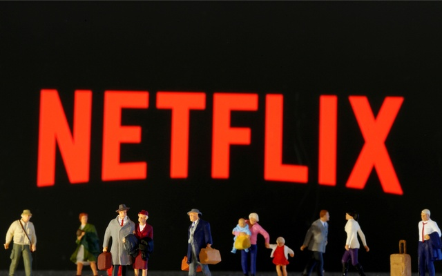Small toy figures are seen in front of displayed Netflix logo in this illustration taken Mar 19, 2020. REUTERS