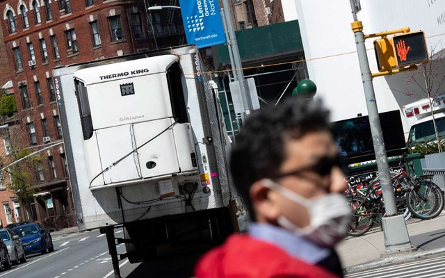 A refrigerated truck is seen outside Lenox Health Medical Pavilion during the outbreak of the coronavirus disease (COVID-19) in New York City, US, April 19, 2020. REUTERS