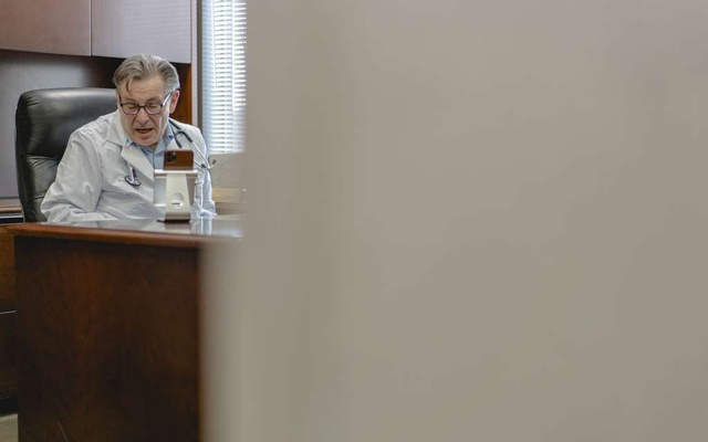 Dr Bruce K Lowell, an internist, teleconferences with a patient at his office in Great Neck, NY, April 16, 2020. The New York Times