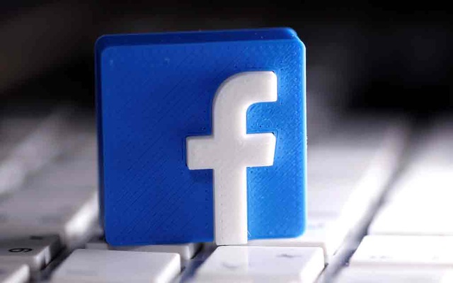 3D-printed Facebook logo is seen placed on a keyboard in this illustration taken March 25, 2020. REUTERS