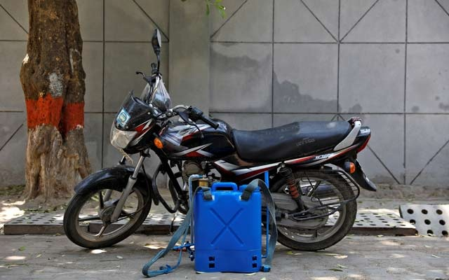 A disinfectant dispenser tank used by Dev Dutt Sharma, a sanitation worker, is pictured next to his bike, on a street, during an extended nationwide lockdown to slow the spread of the coronavirus disease (COVID-19), in New Delhi, India, April 21, 2020. Picture taken April 21, 2020.REUTERS