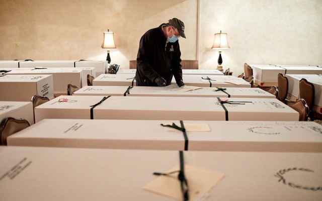 David Penepent documents the deceased at the Gerard J Neufeld Funeral Home in Queens, April 16, 2020. The New York Times