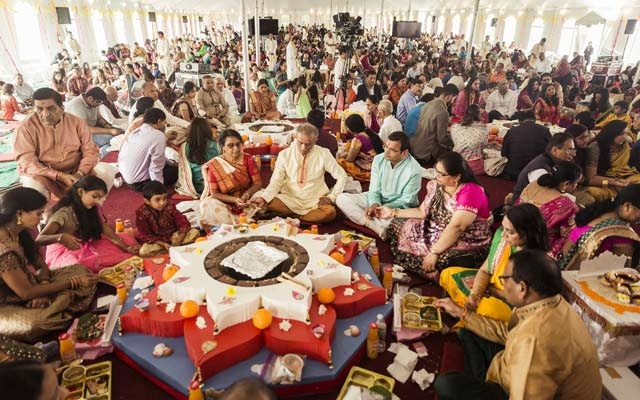 Families gather for a yagna, or ritual, in a large tent outside the Bochasanwasi Shri Akshar Purushottam Swaminarayan Sanstha, or BAPS Hindu temple, in Melville, NY, Oct 8, 2016.
