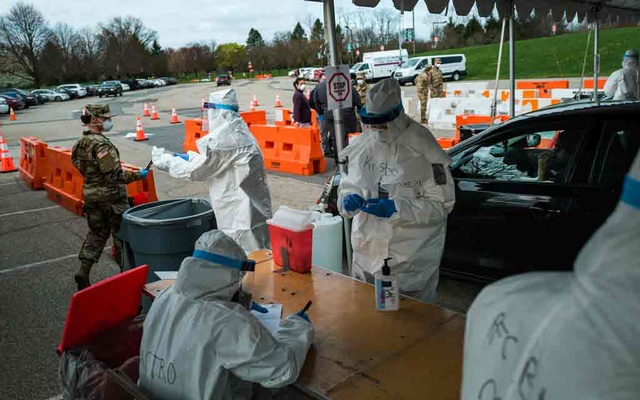 FILE - Health care workers collect samples at a drive-thru coronavirus testing site in Paramus, N.J., April 7, 2020. The coronavirus pandemic is shaking fundamental assumptions about American exceptionalism — the special role the US played for decades after World War II as the reach of its values and power made it a global leader and example to the world, but today it is leading in a different way: Some 800,000 Americans have been diagnosed with Covid-19 and at least 42,094 have died, more than anywhere else in the world. (Ryan Christopher Jones/The New York Times)