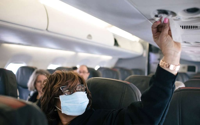 Acquanetta Garth wipes down her surroundings on an American Airlines flight at the Detroit Metropolitan Wayne County Airport on March 3, 2020. The New York Times