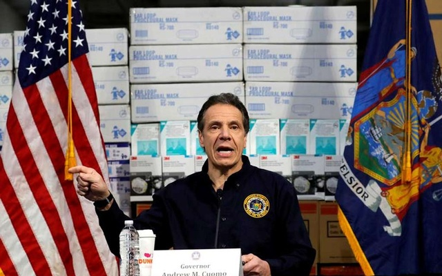 New York Governor Andrew Cuomo speaks in front of stacks of medical protective supplies during a news conference at the Jacob K. Javits Convention Centre which will be partially converted into a temporary hospital during the outbreak of the coronavirus disease (COVID-19) in New York City, New York, US, March 24, 2020. REUTERS