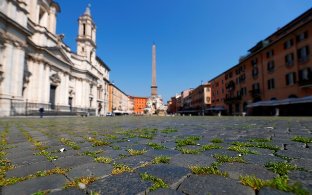 Grass grows on Rome's popular Piazza Navona square after a huge drop in the number of visitors in Rome, Italy, April 9, 2020. REUTERS