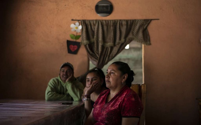 Maria Alejandre with family members in their home in Aporo, Mexico, April 15, 2020. Migrant workers globally send hundreds of billions of dollars home every year, but the economic paralysis with the coronavirus pandemic threatens that. (Alejandro Cegarra/The New York Times)