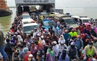 Hundreds of passengers crossing the Padma River on a packed ferry on Wednesday as the authorities resumed river transport services on the Shimulia-Kathalbari route amid the coronavirus crisis.