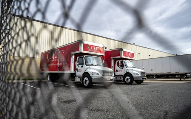 Trucks outside the Cort Furniture Rental warehouse in North Bergen, N.J., April 18, 2020. Cort, which is owned by Berkshire Hathaway, is one of many American companies which appears to have taken advantage of the coronavirus crisis to target unionised workers, or those planning to unionise. (Ben Solomon/The New York Times)