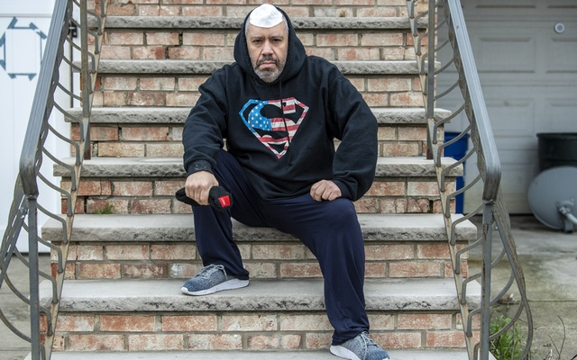 """Julio Perez, a warehouse worker for Cort Furniture Rental, at home in Bayonne, N.J., April 17, 2020. Cort, which is owned by Berkshire Hathaway, is one of many American companies which appears to have taken advantage of the coronavirus crisis to target unionised workers, or those planning to unionise. """"They fired us because we tried to start a union,"""" Perez said. (Ben Solomon/The New York Times)"""