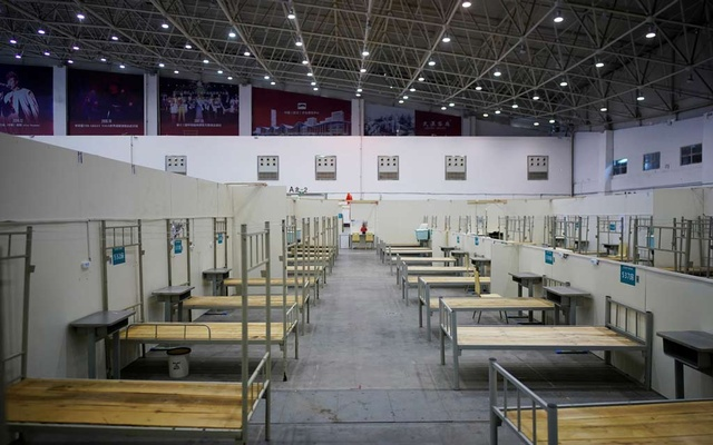 Bed frames are seen inside a convention center that was used as a makeshift hospital to treat patients with the coronavirus disease (COVID-19), in Wuhan, Hubei province, China April 9, 2020. REUTERS