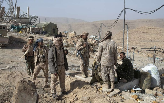FILE -- Yemeni fighters loyal to the Saudi-led coalition at a front line atop a mountain in Fardhat Nehim-Nehim District, Yemen, Jan. 23, 2019. A declaration of self-rule over the weekend by Yemen's leading separatist group, which seized control of the southern port city of Aden and its Central Bank, threatens fresh chaos in the war-torn country and has complicated Saudi efforts to withdraw from the war. (Tyler Hicks/The New York Times)