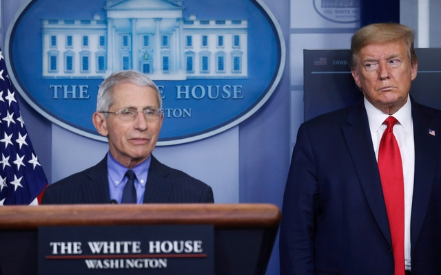 US President Donald Trump looks at National Institute of Allergy and Infectious Diseases Director Dr Anthony Fauci as Fauci answers a question during the daily coronavirus task force briefing at the White House in Washington, US, April 17, 2020. Reuters