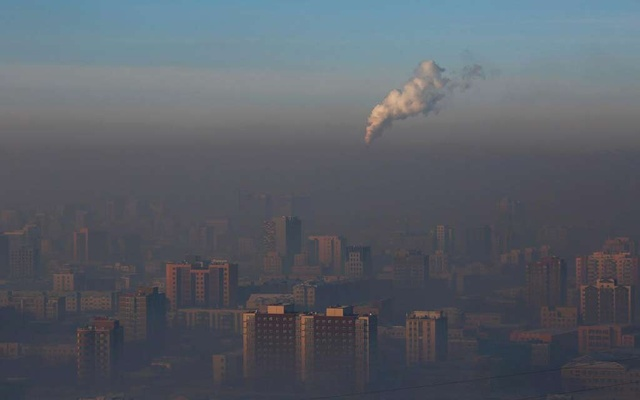 Emissions from a power plant chimney rise over Ulaanbaatar, Mongolia January 13, 2017. REUTERS/B Rentsendorj