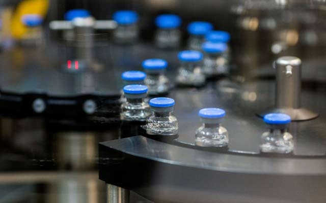 Vials of investigational coronavirus disease (COVID-19) treatment drug remdesivir are capped at a Gilead Sciences facility in La Verne, California, US March 18, 2020. REUTERS