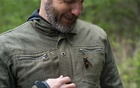 Chris Looney, a Washington State entomologist, displays a dead two-inch Asian giant hornet on his jacket in Blaine, Wash, on Apr 23, 2020. The New York Times