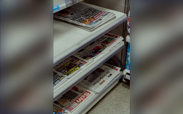 Newspapers on display at a Tesco Metro in London, April 28, 2020. The New York Times