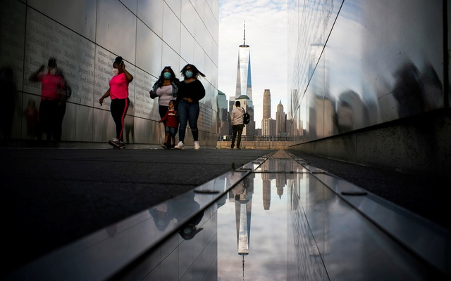 People visit the Empty Sky Memorial as the The One World Trade Center in New York is seen from Liberty State Park after many New Jersey Parks set to re-open during the outbreak of the coronavirus disease (COVID-19) in Jersey City, New Jersey, US, May 2, 2020. Reuters