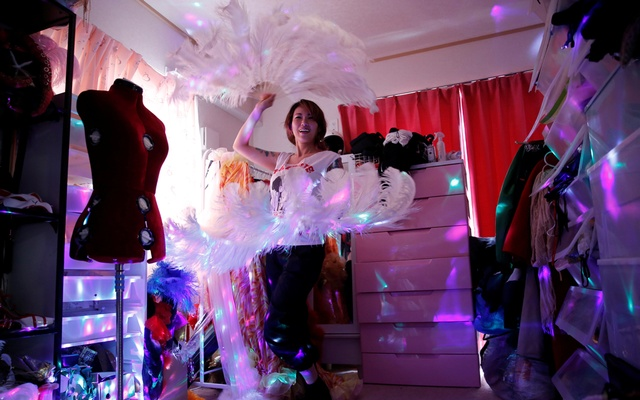 Burlesque show exotic dancer Aya Yumiko who performs under the name Aya Mermaid, poses with her show props at her house amid the coronavirus disease (COVID-19) outbreak, in Tokyo. REUTERS