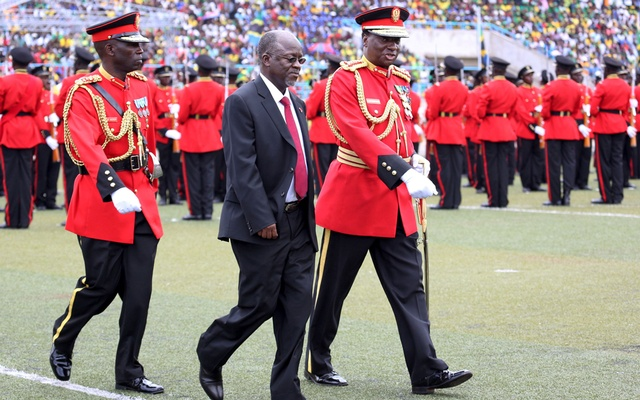 Tanzania's President-elect John Magufuli is escorted after inspecting a Tanzanian military guard of honour during his inauguration ceremony at the Uhuru Stadium in Dar es Salaam, November 5, 2015. REUTERS