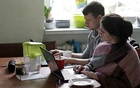 FILE PHOTO: Two people work from home during the outbreak of coronavirus disease (COVID-19), in Gdynia, Poland, March 16, 2020. REUTERS/Eloy Martin