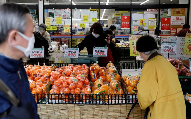 Shoppers wearing protective face masks, following an outbreak of the coronavirus disease (COVID-19), are seen at a supermarket in Tokyo, Japan March 27, 2020. REUTERS