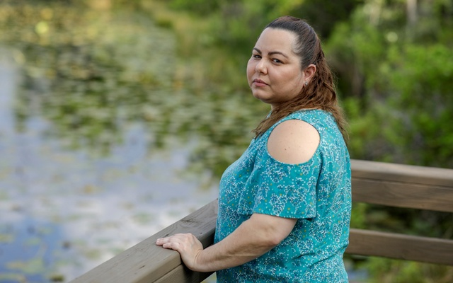 Claudia Alejandra, 37, furloughed from her job at the makeup counter at Macy's amid the coronavirus disease (COVID-19), poses for a portrait near a lake in Orlando, Florida, US, March 6, 2020. REUTERS
