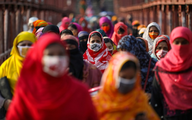 Garment workers return from a workplace as factories reopened after the government has eased the restrictions amid concerns over the coronavirus disease in Dhaka. REUTERS