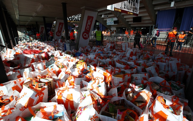 Bags with food and essential products received from donations are seen ready to be distributed to people in need at Vernets ice rink in Geneva, following the outbreak of the coronavirus disease (COVID-19), Geneva, Switzerland, May 9, 2020. REUTERS