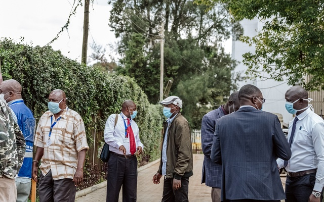 Members of the Ministry of Health outside of the Kenya Medical Training College, where suspected coronavirus patients are being quarantined, in Nairobi, Kenya, on Wednesday, May 6, 2020. The New York Times