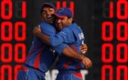 Afghanistan's Samiullah Shinwarai (L) and Shafiqullah Shafaq celebrate the wicket of Bangladesh's Shuvagoto Hom Chowdhury during their gold medal cricket match at the 16th Asian Games in Guangzhou, Guangdong province November 26, 2010. REUTERS/Mick Tsikas