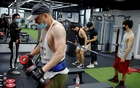 As Beijing gyms reopen, users are masked up and ready to shed pounds