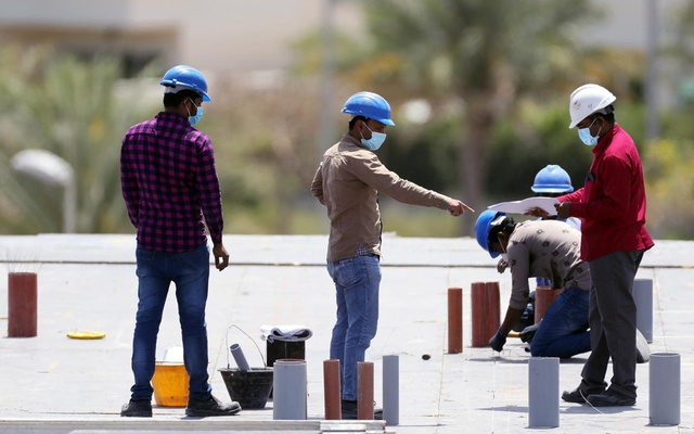 Workers wearing protective face masks work on a residential construction site, following the outbreak of coronavirus disease (COVID-19), in Dubai, United Arab Emirates, April 14, 2020. REUTERS