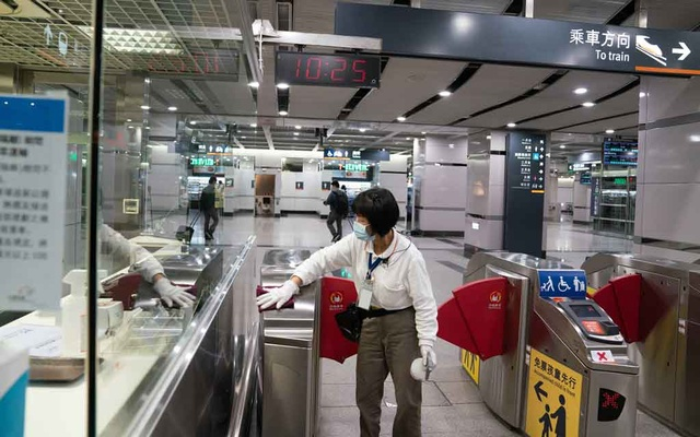 A member of the Taiwan High Speed Rail cleaning staff sanitizes equipment inside Nangang station, in Taipei, Taiwan, on April 30, 2020 The New York Times