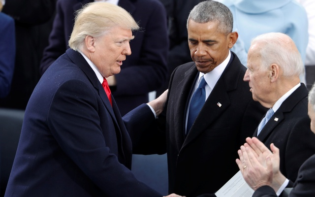 US President Donald Trump greets former Vice President Joe Biden and former President Barack Obama after being sworn in as president of the United States at US Capitol in Washington. REUTERS