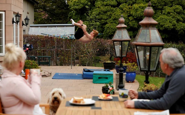 Team GB Diver James Heatly during a training session at his home in Balerno with his dad Robert and Mum Deborah, following the outbreak of the coronavirus disease (COVID-19), Balerno, Scotland, Britain, May 7, 2020. Reuters