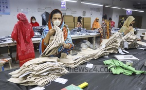 Workers wearing face masks sew garment at a factory in Dhaka's Mirpur amid the coronavirus outbreak. Photo: Asif Mahmud Ove