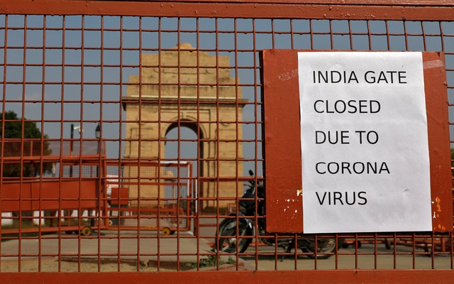 FILE PHOTO: A sign pasted on a security barricade is seen after the India Gate war memorial was closed for visitors amid measures for coronavirus prevention in New Delhi, India, March 19, 2020. REUTERS
