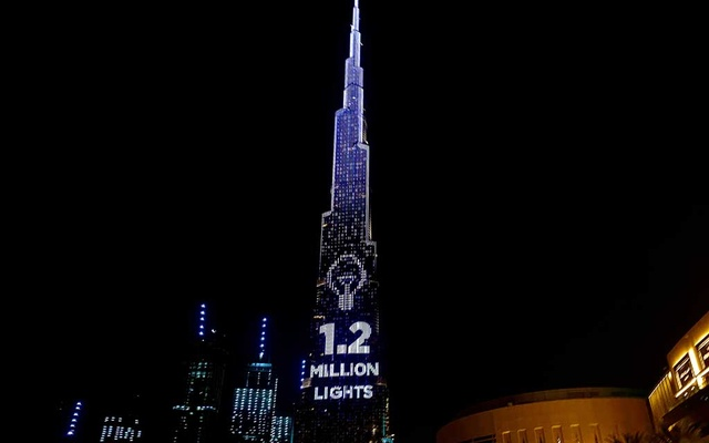 Dubai's Burj Khalifa, the world's tallest building, lit its 1.2 million lights to become the world's tallest donation box to buy meals for people hit by the impact of the new coronavirus disease (COVID-19) pandemic in Dubai, United Arab Emirates May 11, 2020. REUTERS